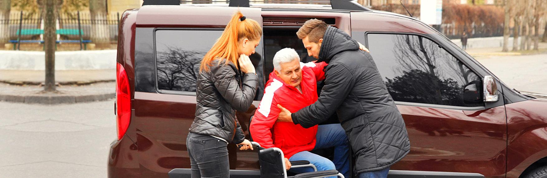 couple helping a senior man